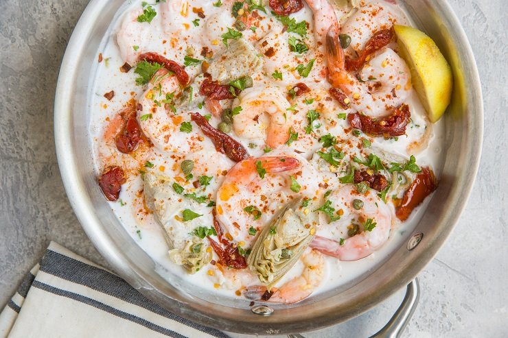 Easy Dairy-Free Creamy Tuscan Shrimp Recipe with artichoke hearts and sun-dried tomatoes. An easy main dish or side dish.