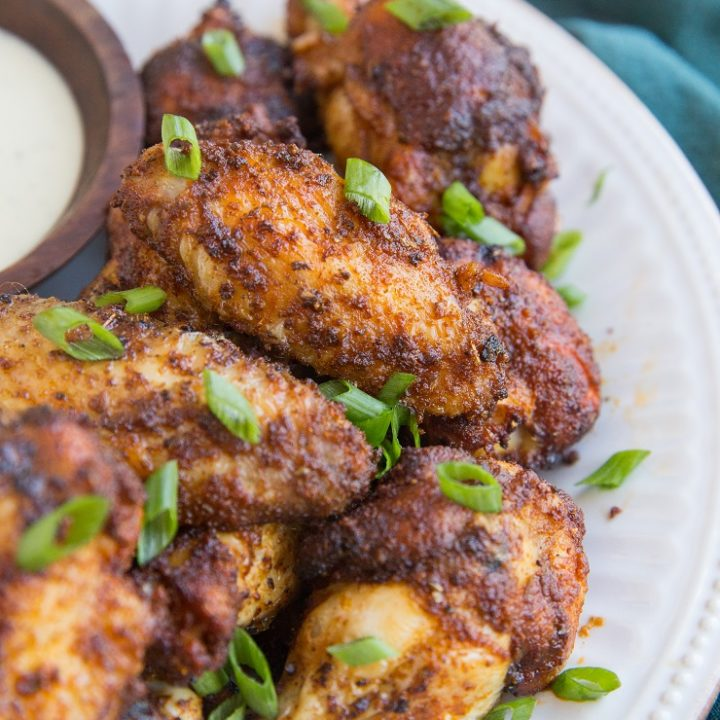 Air Fryer Chicken Wings are incredibly tender yet crispy! Made with only a few basic ingredients, this easy recipe makes a delicious appetizer