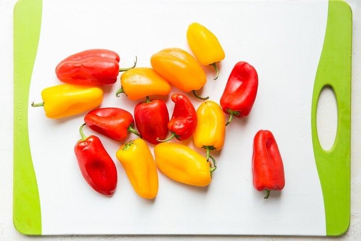 Sweet mini peppers on a cutting board