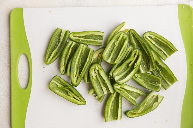 Slice the tops off of the jalapenos and cut in half lengthwise. Remove the seeds