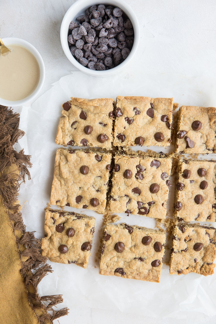 Flourless Tahini Chocolate Chip Cookie Bars made with just 6 basic ingredients are loaded with chocolaty flavor. Grain-free, refined sugar-free, dairy-free and so easy to make!