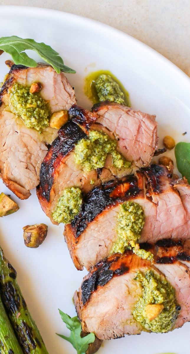 Perfect, easy Grilled Pork Tenderloin with the most amazing pork marinade! An easy tutorial on making the best grilled pork tenderloin. Everything you need to know!