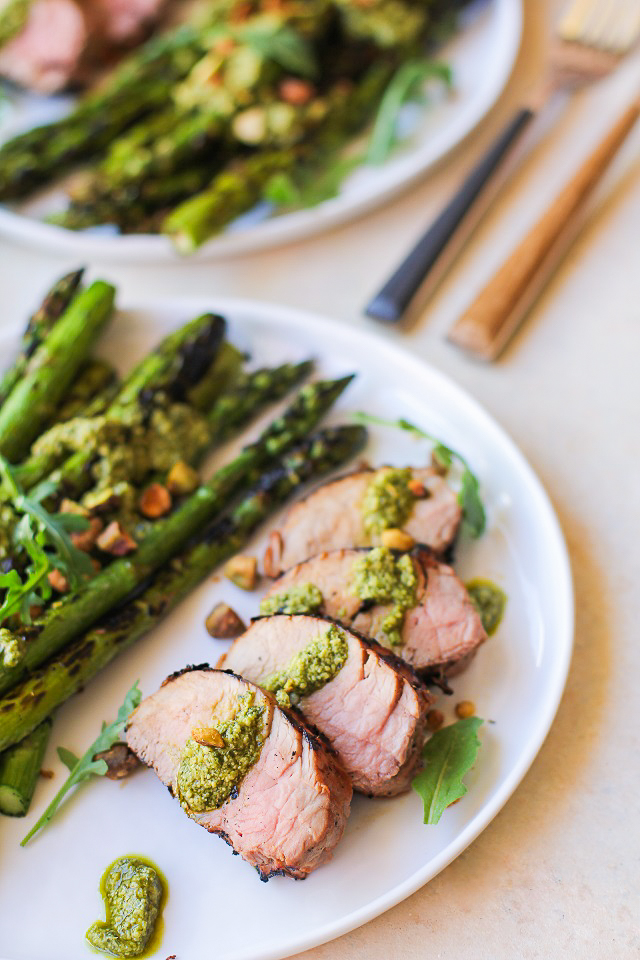 Easy Perfect Grilled Pork Tenderloin with an amazing marinade! Serve it up with grilled asparagus and pesto for an amazing meal