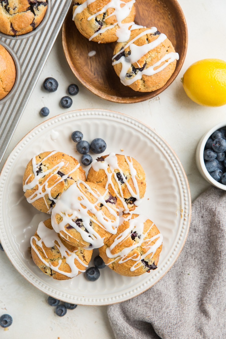 Keto Lemon Poppy Seed Blueberry Muffins made with almond flour - grain-free, sugar-free, insanely moist and fluffy! You'd never guess these muffins are gluten-free and sugar-free!