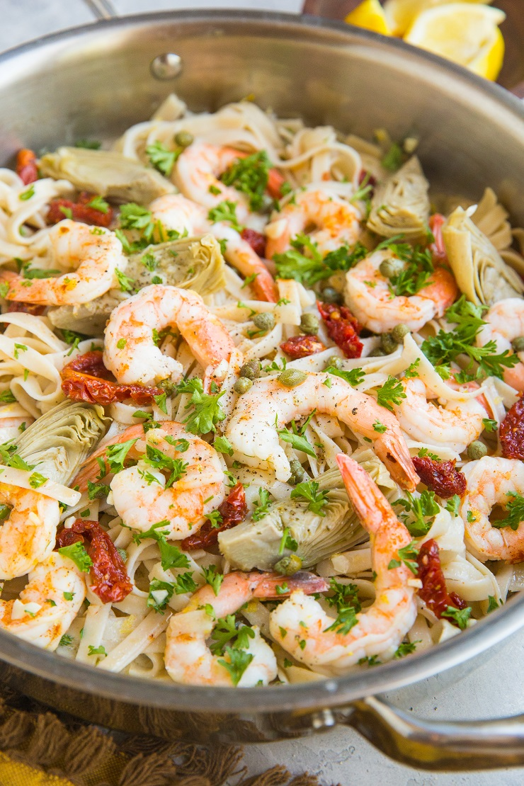 Gluten-Free Dairy-Free Mediterranean Shrimp Pasta with sun-dried tomatoes, artichoke hearts and capers in a lemon garlic cream sauce (that happens to be dairy-free)
