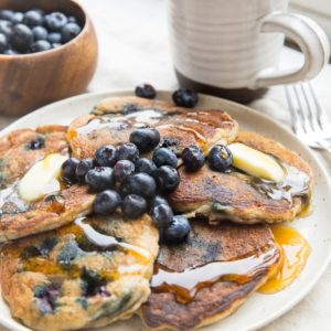 Paleo Blueberry Pancakes made with coconut flour. Low-carb, dairy-free and keto friendly! An easy, delicious breakfast recipe.