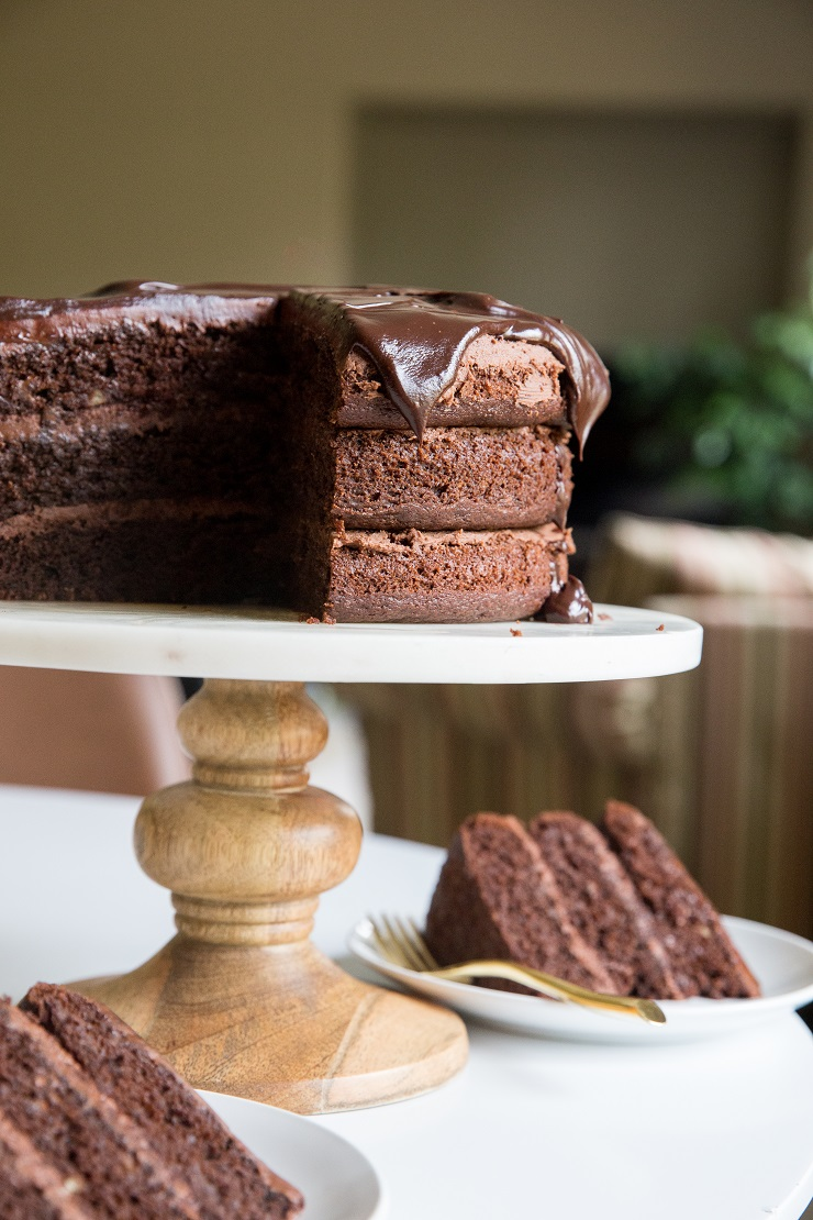 Paleo Triple Chocolate Cake - moist, rich, insanely chocolatey cake with chocolate buttercream and chocolate ganache. Perfect for the chocoholics of the world!