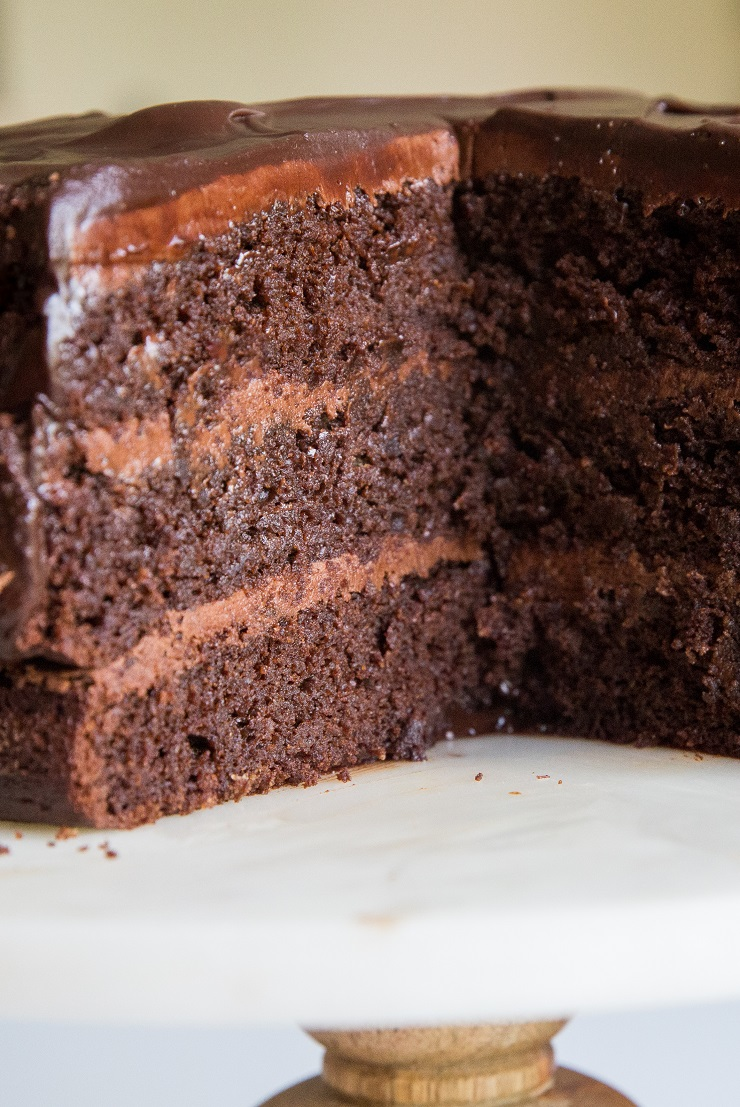Paleo Death by Chocolate Cake - a triple chocolate cake recipe made grain-free, dairy-free and refined sugar-free with chocolate buttercream and ganache
