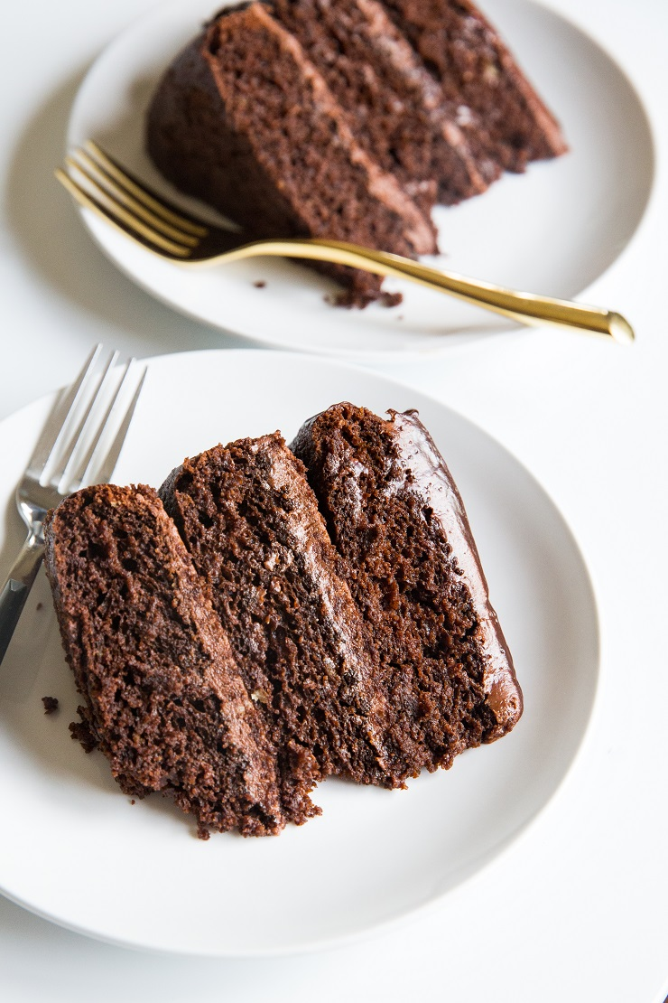 Triple Chocolate Paleo Chocolate Cake made with chocolate buttercream and ganache. Grain-free, refined sugar-free, dairy-free, moist, rich and decadent!