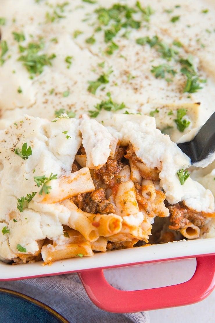 Dairy-Free Gluten-Free Baked Ziti Pasta with ground beef, red sauce and creamy cauliflower sauce instead of cheese