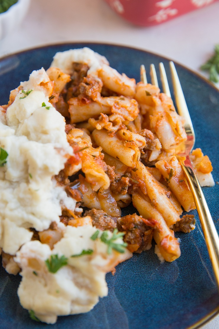 Gluten-Free Dairy-Free Baked Ziti made with gluten-free pasta noodles and a creamy cauliflower sauce instead of cheese.