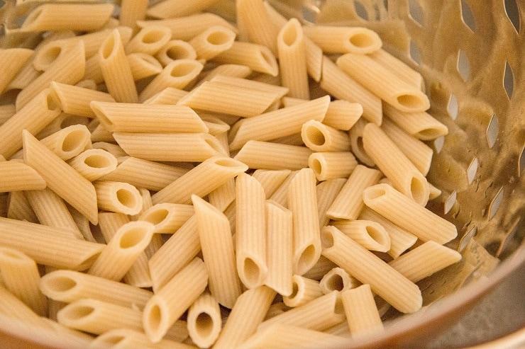 Pasta noodles in a colander