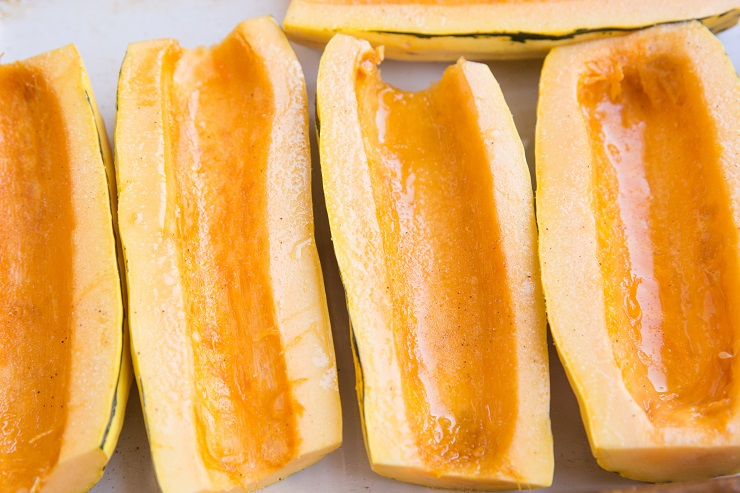 Drizzle the delicata squash with oil and sprinkle with salt