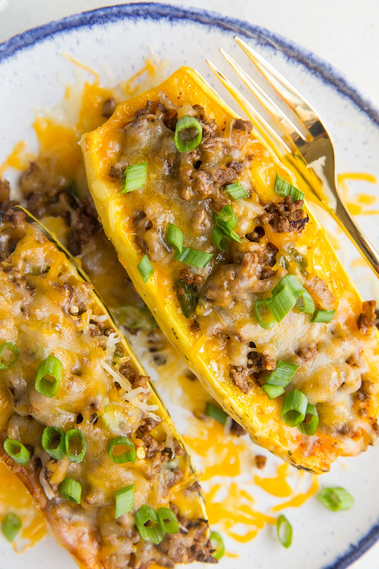 Taco Stuffed Delicata Squash with ground beef and cheese. An easy dinner recipe that is grain-free, gluten-free, easy to prepare and so satisfying!