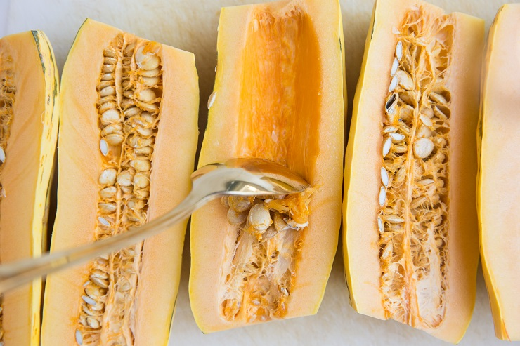 Cut the delicata squash in half and scoop out the insides